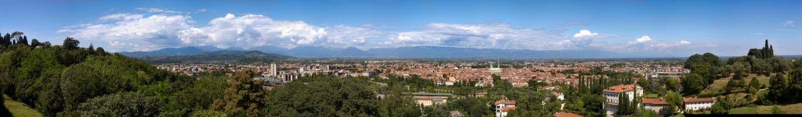 50 Megapixels skyline of vicenza with the mountains on the background during a sunnyday