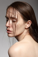 Girl with wet hair half-turned. Natural beauty.