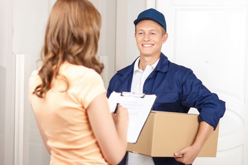 Deliverymen standing with client