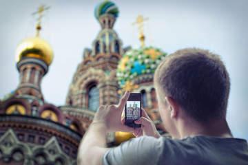 Man taking photos of church