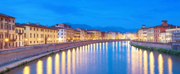 River Arno at night in Pisa, Italy.