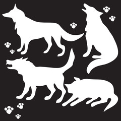 Hand drawn sketch set of wolves silhouettes on black background.