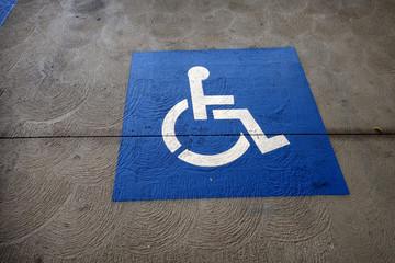 handicap symbol parking sign on street