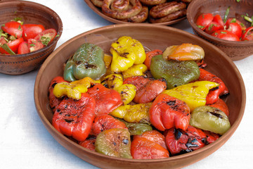 Vegetable dishes and fried sausages