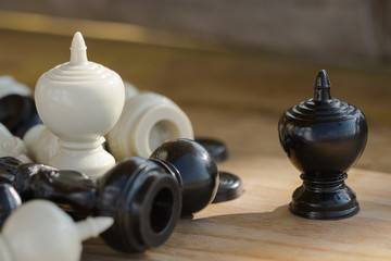 Chess pieces on wooden table, Planing game. chess uniqueness concept on the wooden background.