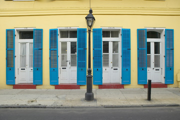 Blue shutter and lamp post in French Quarter near Bourbon Street in New Orleans, Louisiana