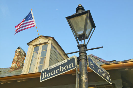 Bourbon Street and St. Philips Street and Lamp post in French Quarter of New Orleans, La.