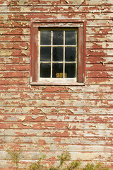 Distressed red barn side and window in Acadia National Park, Maine