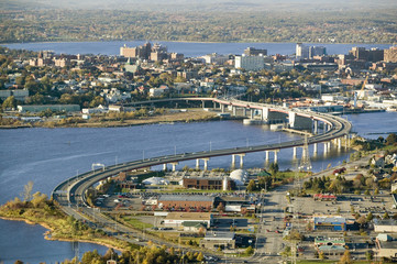 Aerial of downtown Portland, Maine showing Maine Medical Center, Commercial street, Old Port, Back Bay and the Casco Bay Bridge from South Portland