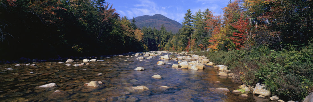 Panoramic view of an autumn waterway along the Kancamagus Highway in the White Mountain National Forest, New Hampshire