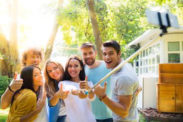 Friends making selfie photo outdoors
