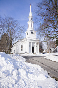 Unitarian Universalist Church surrounded by snow in Lexington, Ma., New England, USA