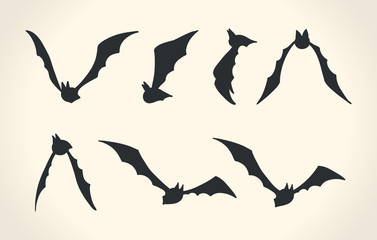 Bat silhouettes in a different poses, Halloween vector illustrat