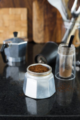 Traditional italian moka  coffee pot filled with fresh ground coffee. Selective focus.
