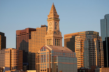 Commerce House Tower (built 1910) and Boston Skyline at sunrise as photographed from Lewis Wharf, Boston, MA.