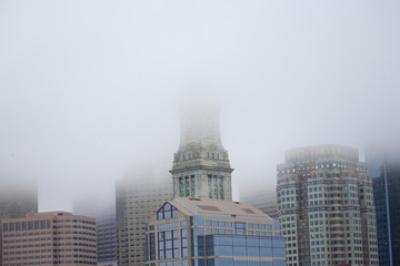 Commerce House Tower (built 1910) and Boston Skyline in deep fog, Boston, MA.