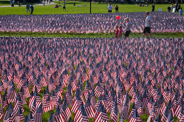 People walk through 20,000 American Flags that, are displayed for every resident of Massachusetts who died in a war over the past 100 years, Boston Common, Boston, MA, Memorial Day, 2012.