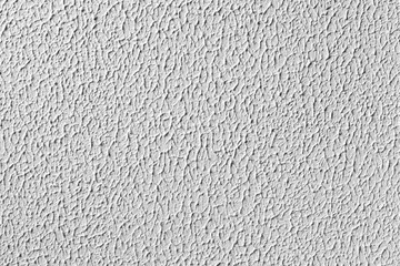 White wall with relief plaster pattern. Background