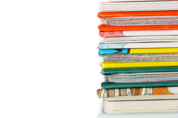 Colourful Books Isolated on White Background. White Background Provides Copy Space to the Left.