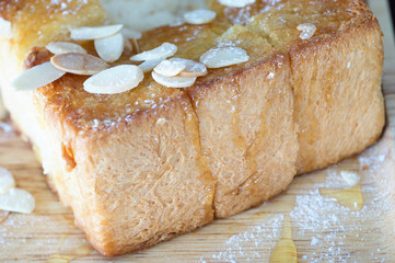 Honey toast with syrup and sliced almonds