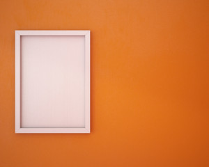 Blank frame on orange wall.