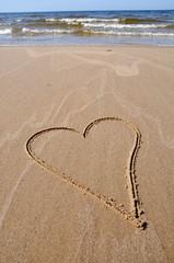 heart drawing on beach sand
