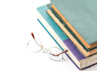 old book with glasses on white background