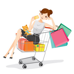 Woman holding card siting in shopping cart, goods, food, beverage, beauty, lifestyle