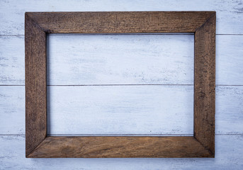 Old wooden frame on white paint wood background
