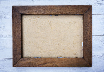 Vintage style wooden frame with natural paper texture