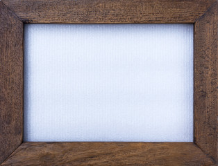 Wooden picture frame and white plastic texture background