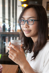 Asia woman drink water.