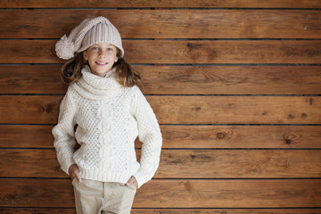 Child posing in knitted clothing