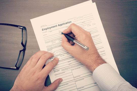 Man fillling a job application form