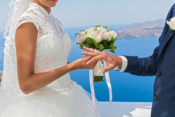 Bride and groom with a bouquet of flowers.