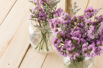 statice flower bouquet  on wood background