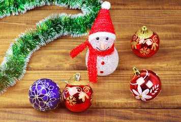 Multicolored christmas toys on wooden background.