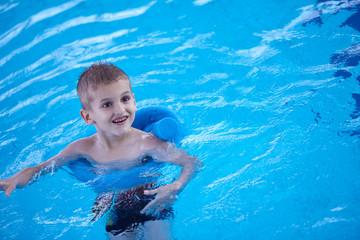 child on swimming poo