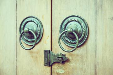 Old handle knob on wood door