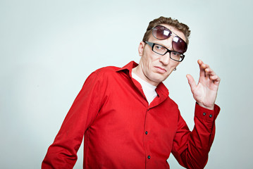 amazed man at two pairs of eyeglasses