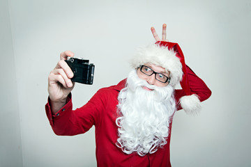Hipster Santa fool around making selfie