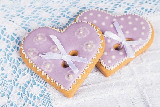 Two purple heart shape gingerbread cookies