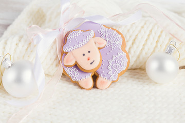 Lavender color gingerbread sheep on white knitted background