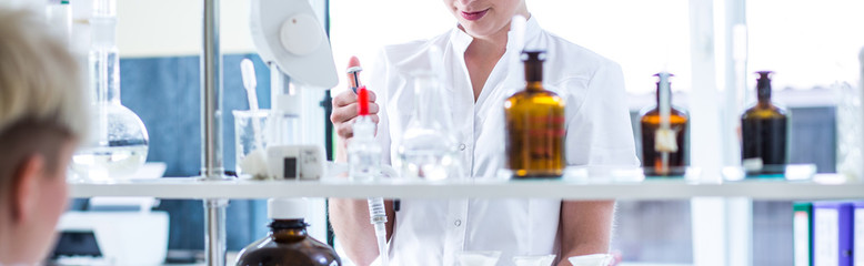 Woman working in chemistry lab