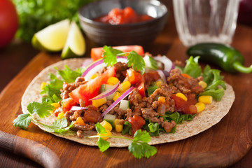 mexican taco with beef tomato salsa onion corn