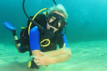 Beautiful blonde woman scuba diving