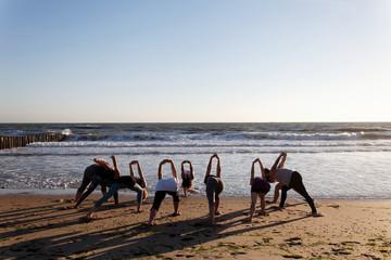 beach yoga lesson by the sea