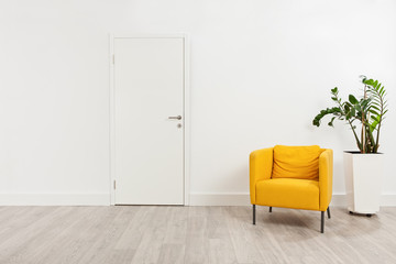 Contemporary waiting room with a yellow armchair