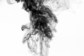 Abstract black smoke swirls over white background