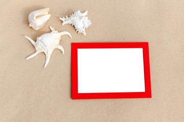 photo frames on sand